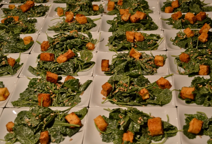 baby kale salad with tahini caesar dressing, fried tofu croutons, toasted sunflower seeds & aged cashew cheese shavings