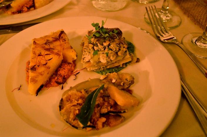 the entree tasting plate: celeriac lasagna with tofu ricotta and arugula walnut pesto, fritto misto of oyster mushrooms with eggplant puree & fried sage leaves, & grilled corn polenta with romesco sauce