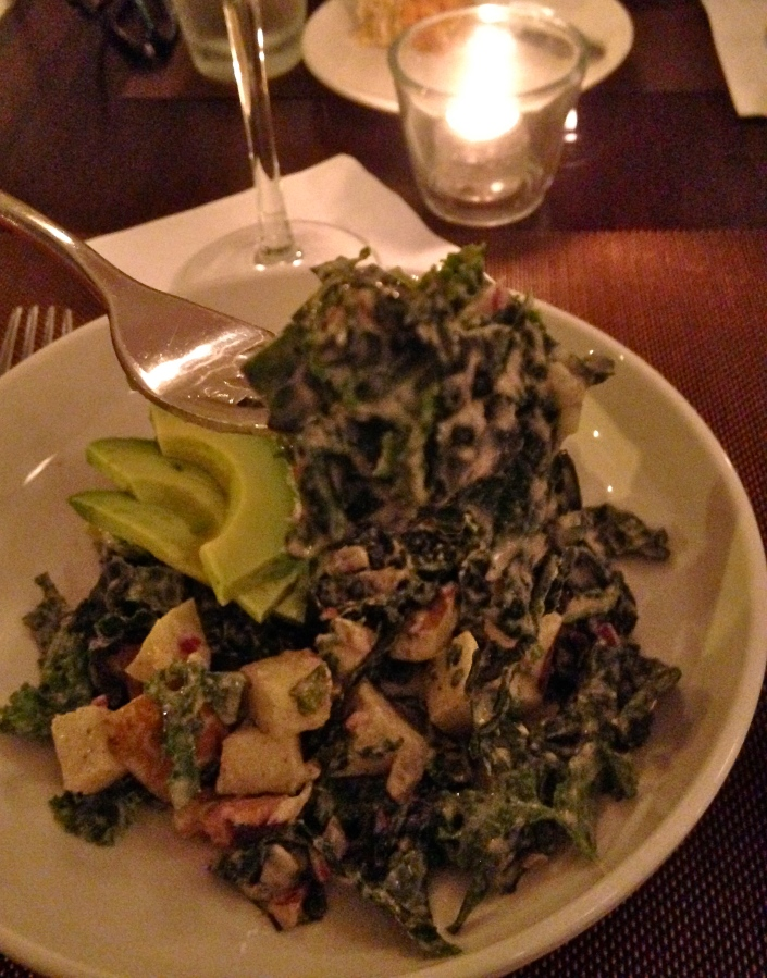 new england chopped kale salad with peppercorn dressing, avocado and pear