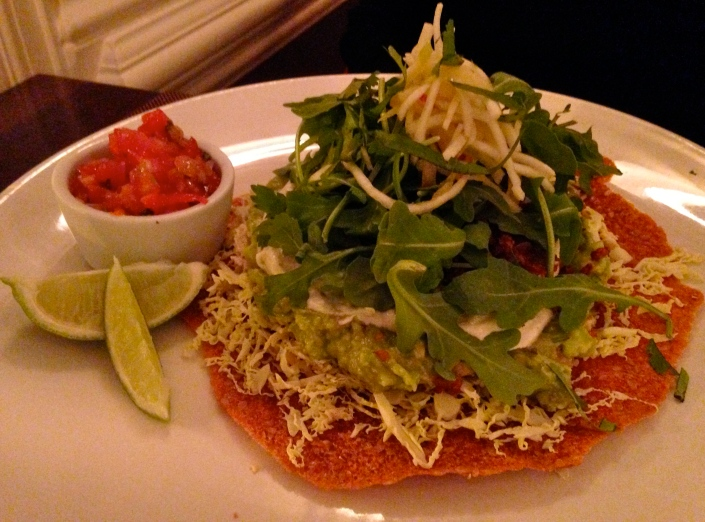 sundried tomato and flax raw tostada with cashew crema, guacamole & salsa
